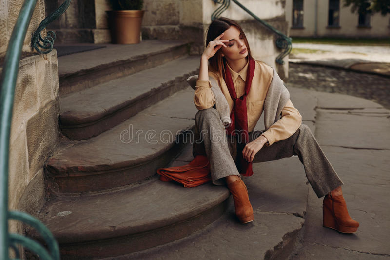 Fashion Model In Street. Beautiful Woman In Fashionable Clothes stock photo