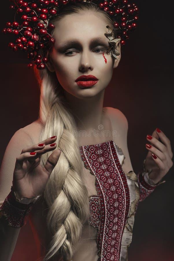 Fashion model in studio. In Ukrainian style royalty free stock photo