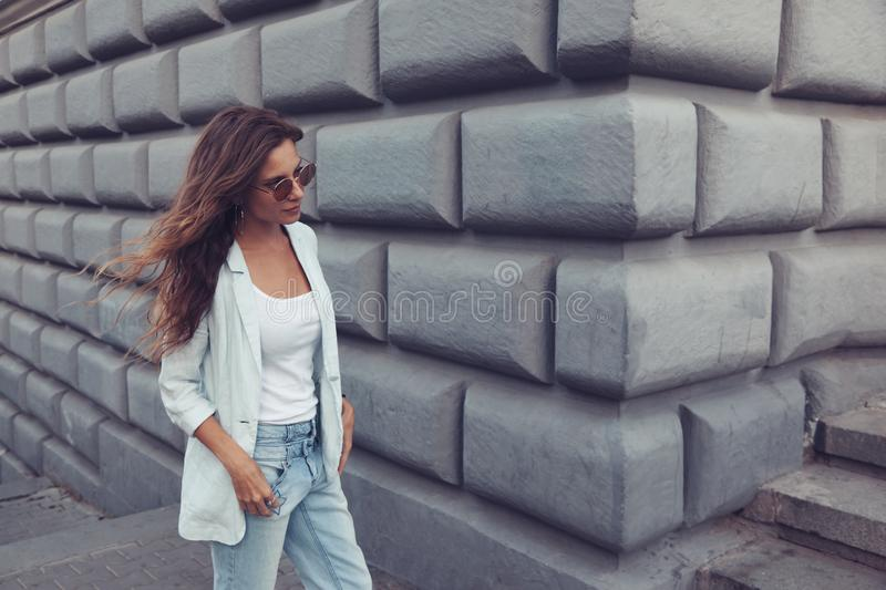 Fashion model walking on the city street royalty free stock photography