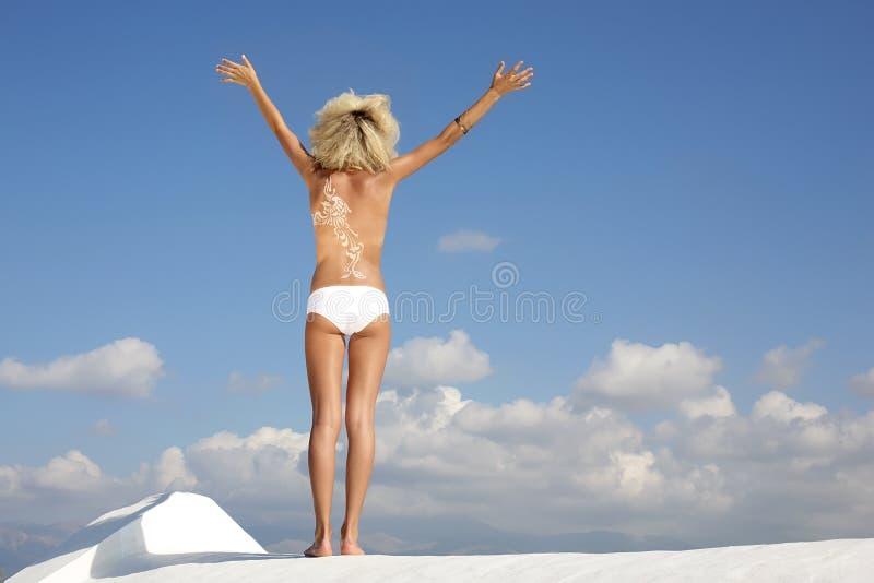 Fashion model wearing body make-up. Over sky background stock image