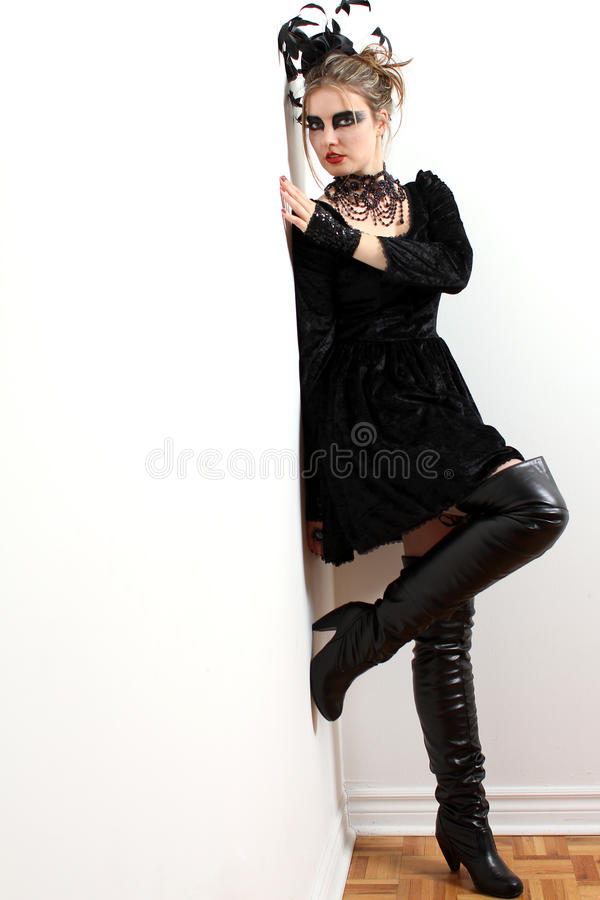 Fashion model wearing a couture dress. Model wearing a couture dress and a black swan make-up stock image