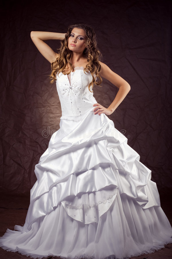 Fashion model wearing wedding dress royalty free stock photography
