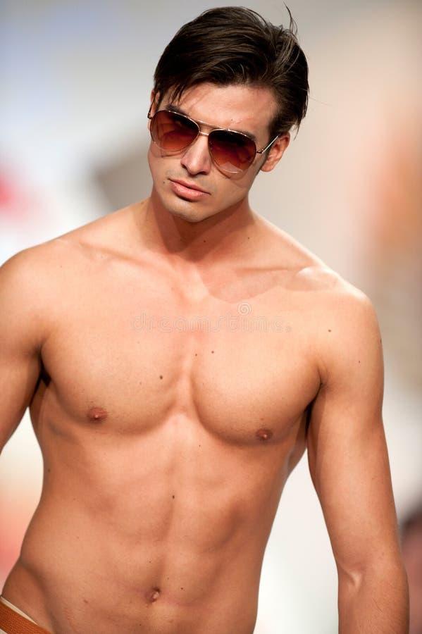 Fashion model wears sunglasses by Catalin Botezatu stock photo