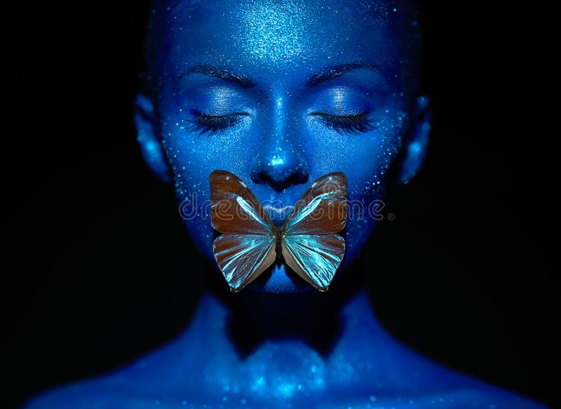 Fashion model woman with blue butterfly royalty free stock image