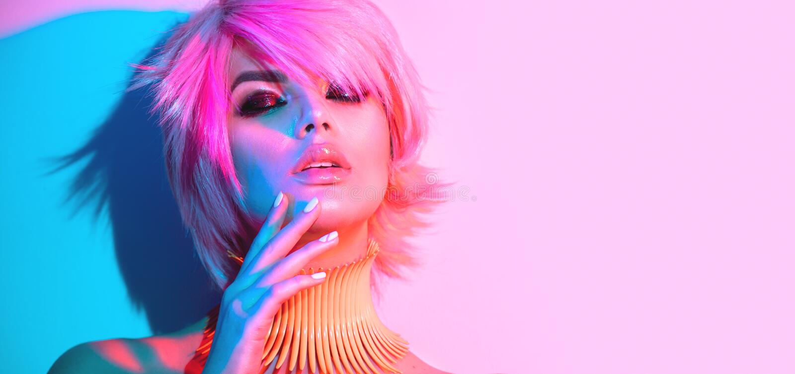 Fashion model woman in colorful bright lights royalty free stock images