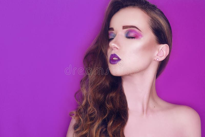 Fashion model woman creative pink and blue make up.  Beauty art portrait of beautiful girl with colorful abstract makeup. royalty free stock photos