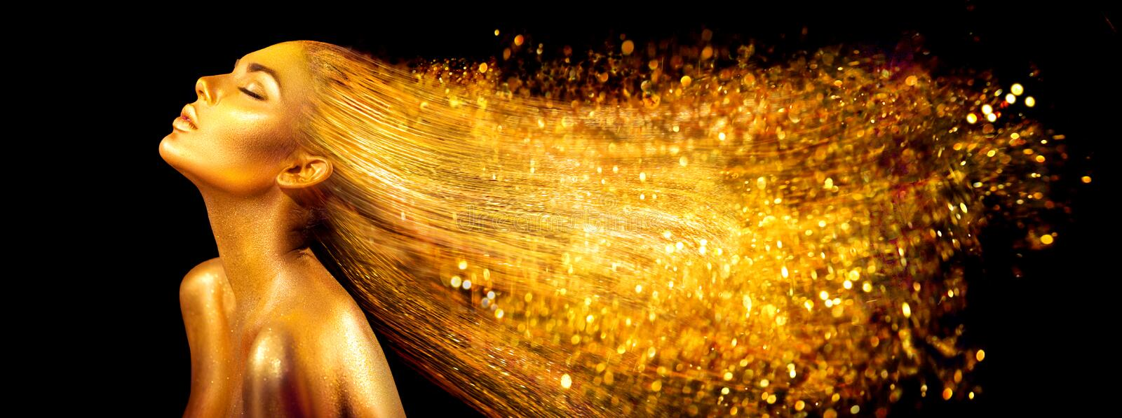 Fashion model woman in golden bright sparkles. Girl with golden skin and hair portrait closeup stock photo