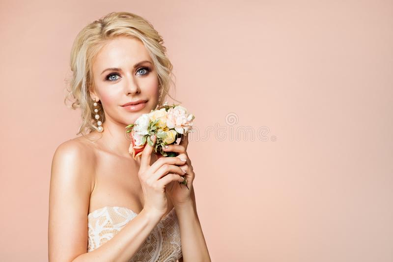 Fashion Models Beauty Portrait with Flowers, Beautiful Woman Nude Makeup and Hairstyle, Girl Studio Shot on Beige stock images