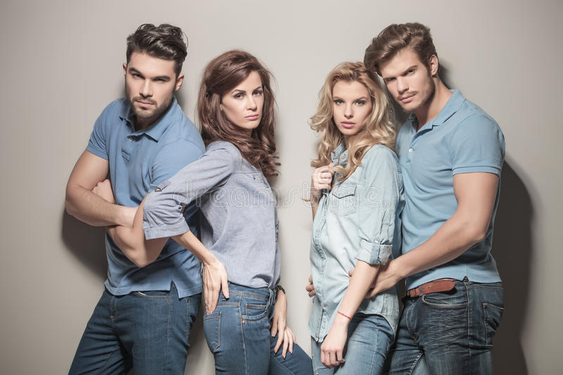 Fashion models in blue jeans and polo shirts. Fashion models in blue jeans and casual polo shirts posing in studio stock images