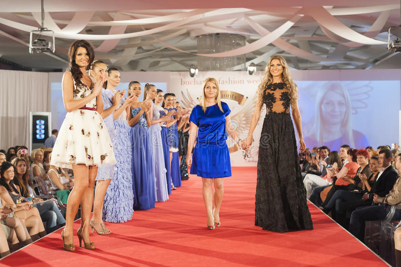 Fashion models on catwalk. BUCHAREST, ROMANIA - JUNE 12: Fashion models wear clothes from Nausica Mircea collection, in Bucharest Fashion Week at World Trade stock images