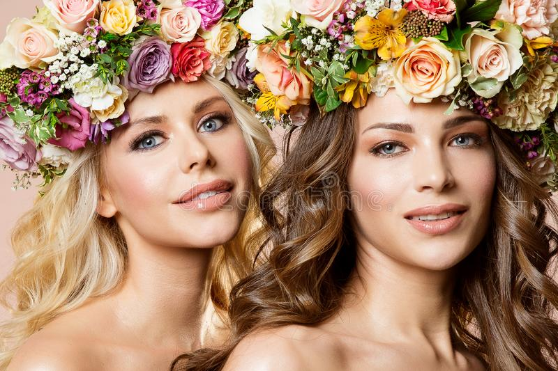 Fashion Models Flowers Hairstyle Beauty Portrait, Two Beautiful Women with Flower in Hair royalty free stock photography