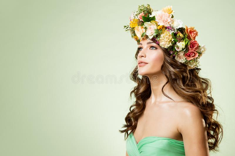 Fashion Models Flowers Wreath Beauty Portrait, Woman Makeup Hairstyle with Roses, Beautiful Girl Flower in Hair. Studio shot on green background stock photography