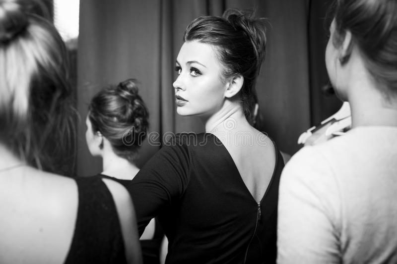 Fashion models prepared for runway by stylish designer. Black and white photography. Plus size fashion models prepared for runway by stylish designer. Black and royalty free stock photography