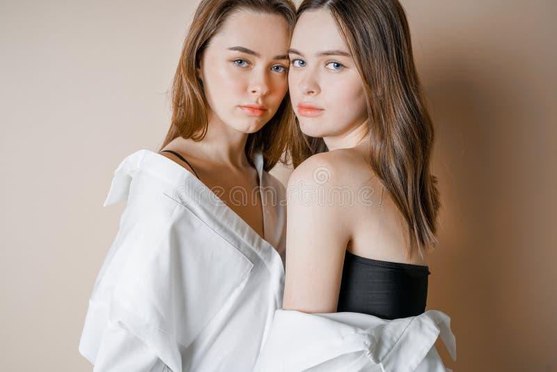 Premium Photo | Fashion beauty models two sisters twins