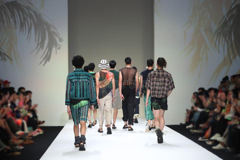 Fashion Models walk back Finale on Runway Ramp during Fashion Week royalty free stock photo