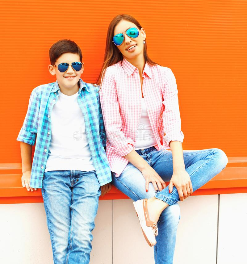 Fashion mother with son teenager in a sunglasses, checkered shirt royalty free stock photos