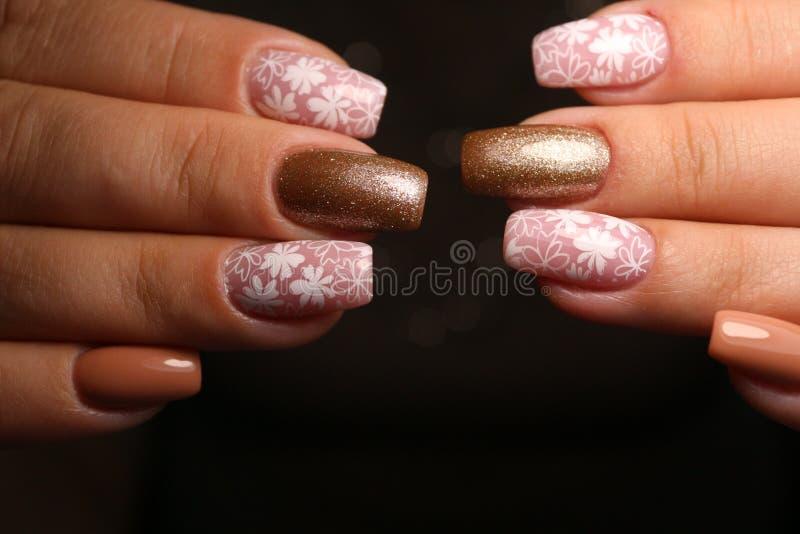 Fashion nails manicure on beautiful female hands stock photography