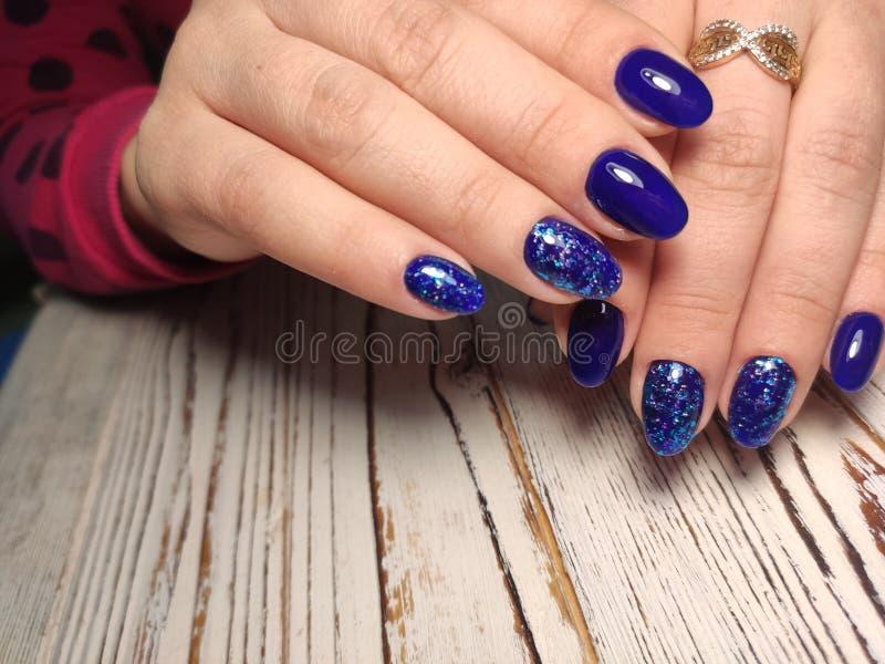 Fashion nails manicure on beautiful female hands stock photos