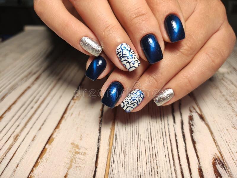 Fashion nails manicure on beautiful female hands royalty free stock image