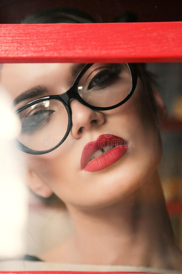 Gorgeous woman with dark hair in elegant glasses. Fashion outdoor photo of gorgeous woman with dark hair in elegant glasses royalty free stock photo