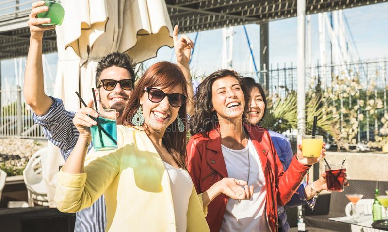 Fashion people dancing music and having fun together at beach party stock photography