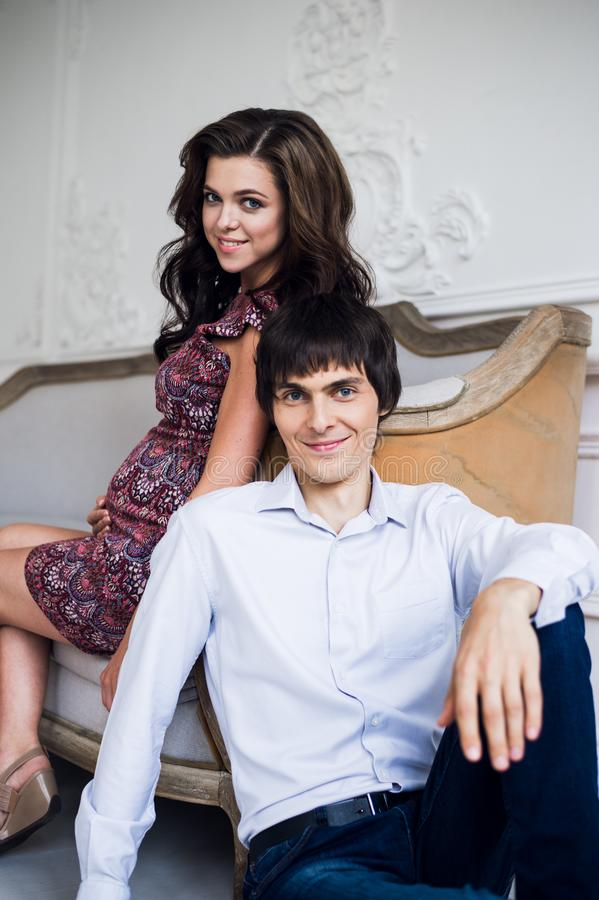 Fashion photo of beautiful couple in elegant clothes. handsome young man posing with gorgeous pregnant wife stock images