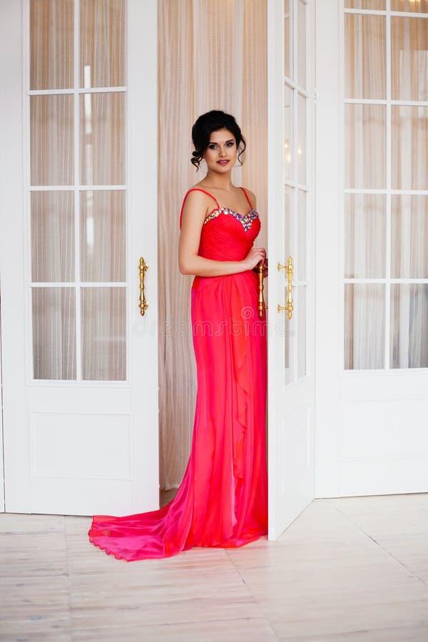 Fashion photo of beautiful lady wearing sparkling evening dress stock photo