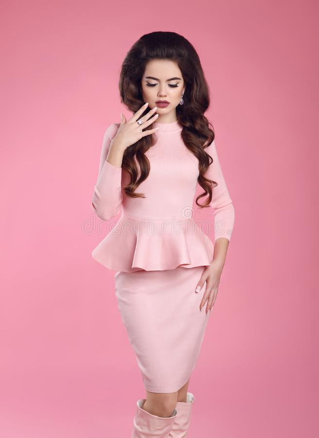 Fashion photo of beautiful young woman in pink dress posing stock photography
