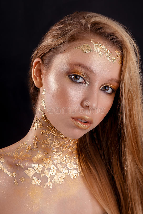 Fashion photo of a beautiful young woman. close up of beauty gold portrait girl royalty free stock photos