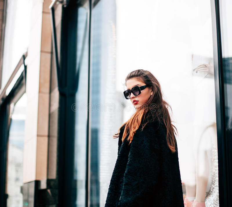 Fashion photo of beautiful young woman with sunglasses. Model looking at camera. City lifestyle. Female fashion. royalty free stock photo