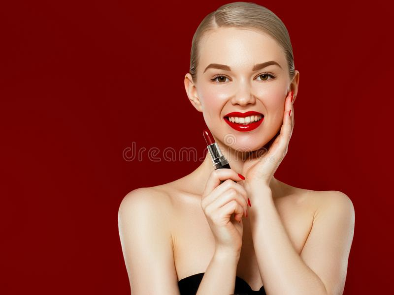 Fashion photo. Closeup of woman face with bright red matte lipstick on full lips. Beauty Cosmetics, Makeup Concept. A royalty free stock photo