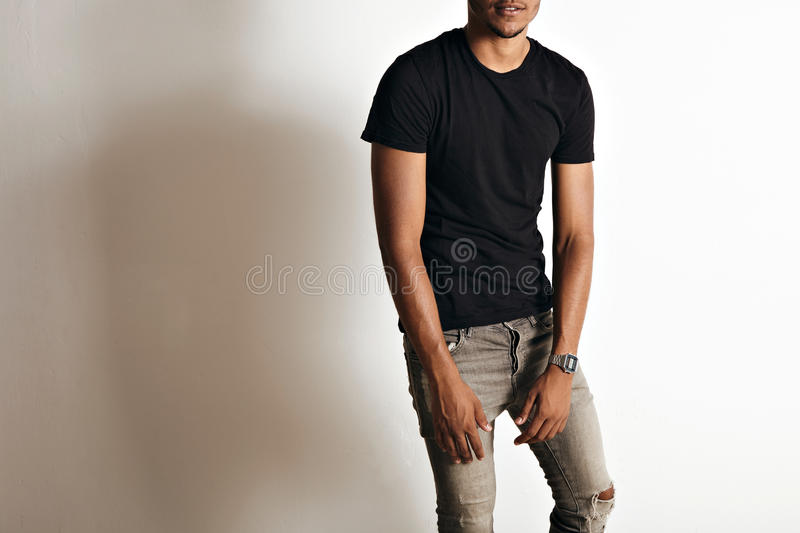 Fashion photo of a handsome man in black t-shirt royalty free stock photos