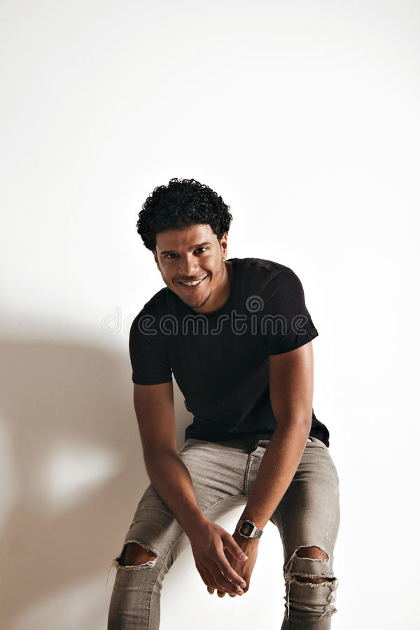 Fashion photo of a handsome man in black t-shirt royalty free stock image