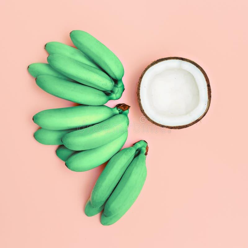 Fashion photo set bananas and coconut. Pink vanilla summer.  royalty free stock photos