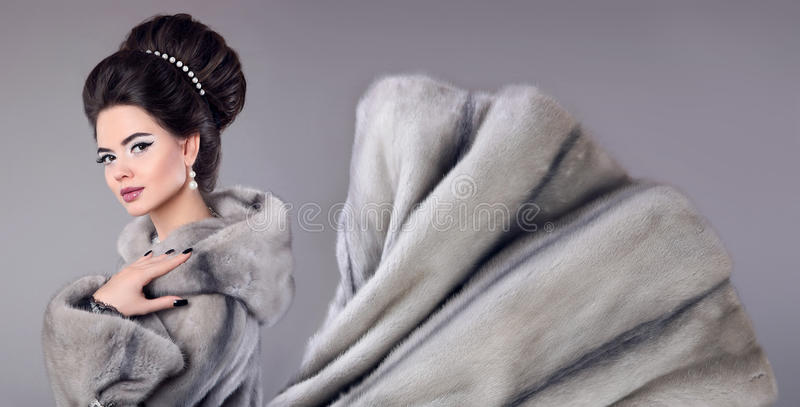 Fashion photo of woman in mink fur coat. Elegant brunette with m stock images