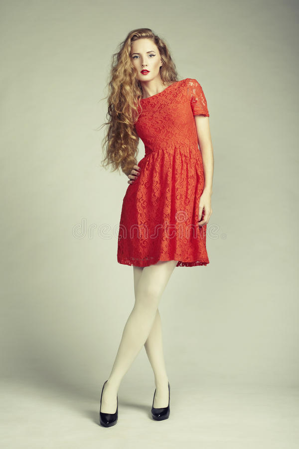 Fashion photo woman in red dress stock photography