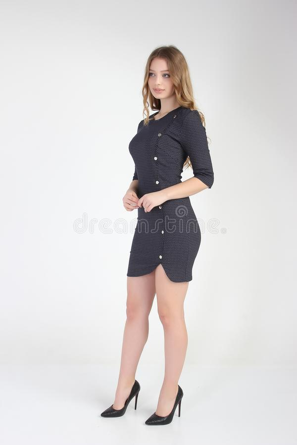 Fashion photo of young beautiful female model in dress. stock image