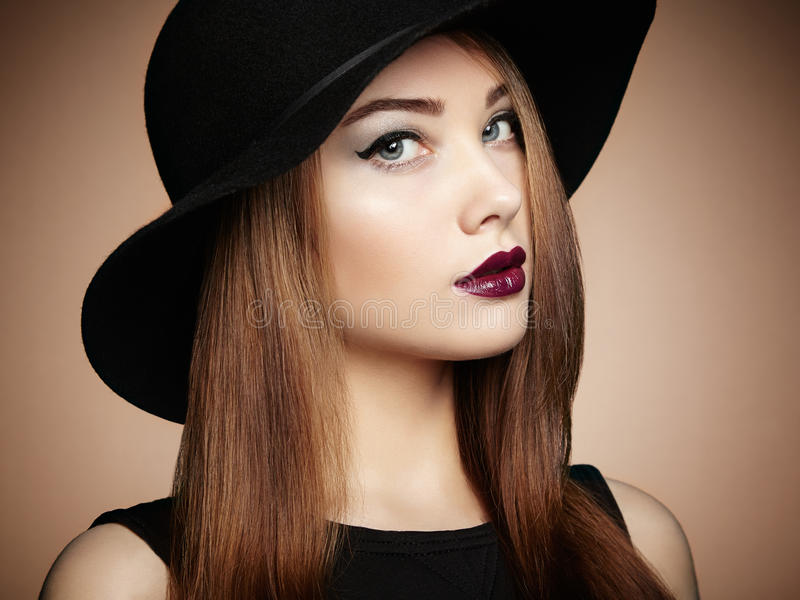 Fashion photo of young magnificent woman in hat. Girl posing royalty free stock photos