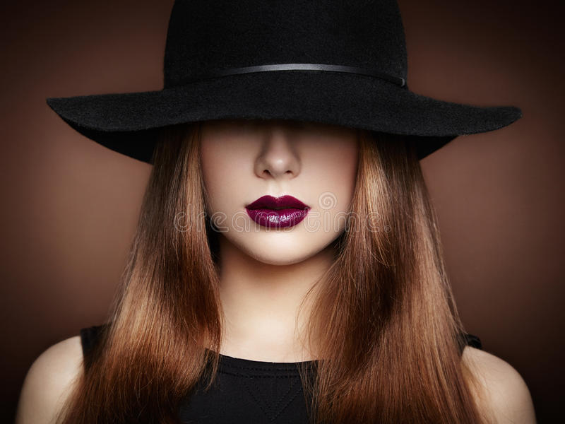 Fashion photo of young magnificent woman in hat. Girl posing. Studio photo. Perfect Makeup stock photography