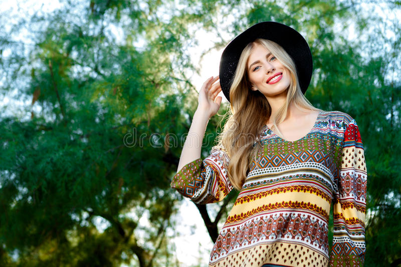 Fashion photo of young magnificent woman wearing fashionable summer clothes. Outdoor fashion photo of young magnificent woman wearing fashionable summer clothes stock image