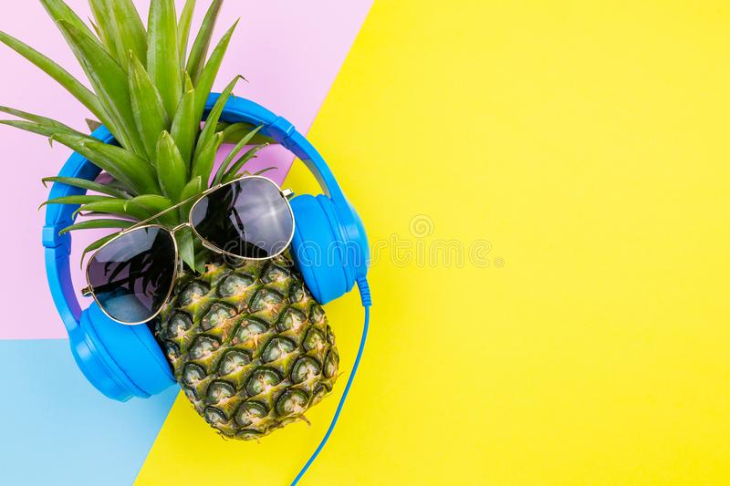 Fashion Pineapple. Bright Summer Color. Beach Clothes Accessories Outfit. Creative Art. Tropical fruit, Stylish Sunglasses. Minim royalty free stock photography