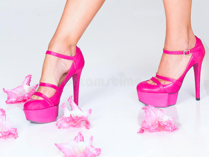 Fashion pink high heels and flowers royalty free stock image