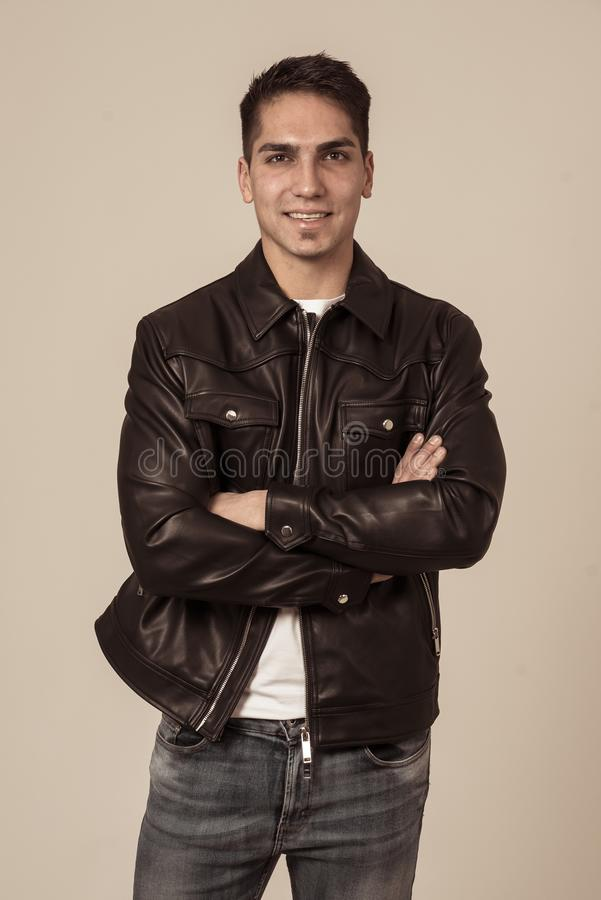Fashion portrait of Attractive young mixed race man model posing in leather jacket stock photo