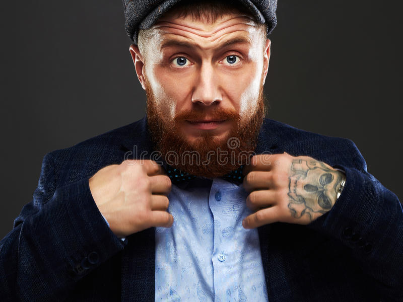 Fashion Portrait of bearded man in suit.old Hipster boy.handsome man in hat.Brutal royalty free stock photos