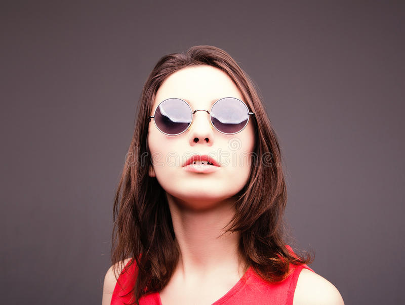 Fashion portrait of a beautiful brunette woman in glasses stock photo