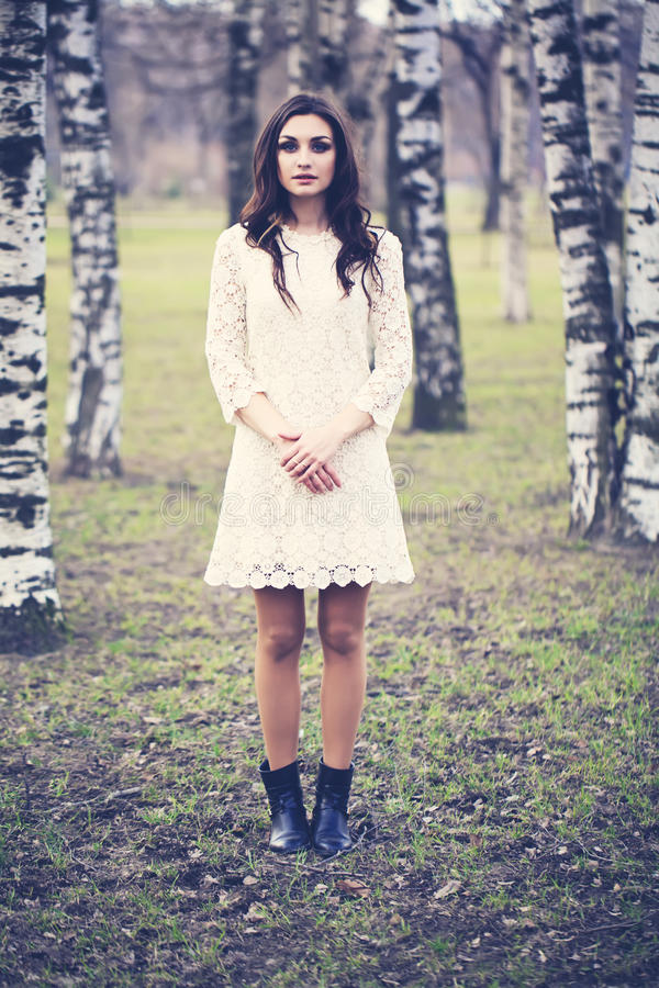 Fashion Portrait of Beautiful Girl in Park. Woman Outdoors. Fashion Portrait of Beautiful Girl in Park. Cute Woman Outdoors stock images