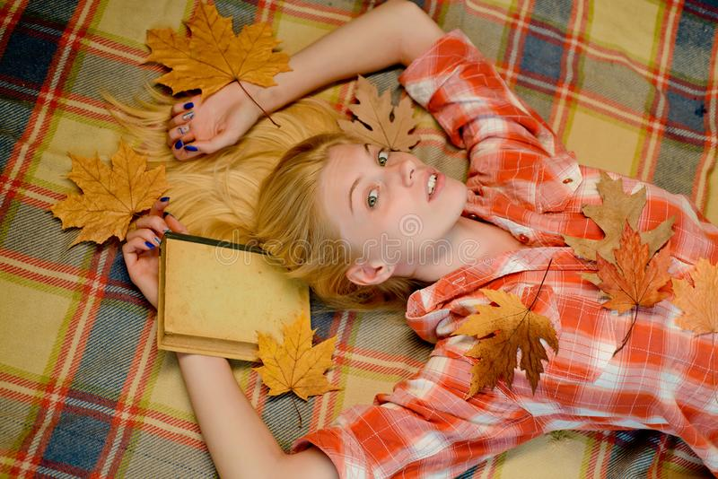 Fashion portrait of beautiful sensual woman. Beautiful sensual blonde playing with leaves. Happy young woman are royalty free stock image