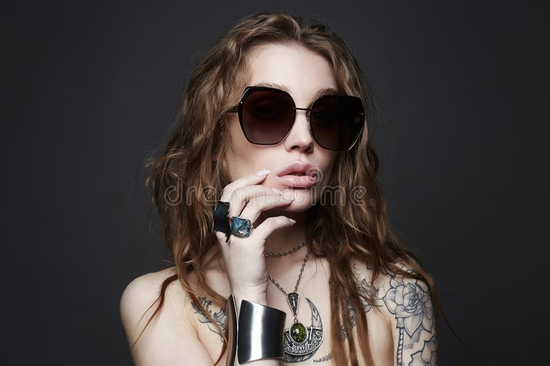 Fashion portrait of Beautiful sexy woman with tattoo royalty free stock image