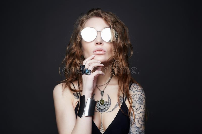 Fashion portrait of Beautiful sexy woman with tattoo royalty free stock photos