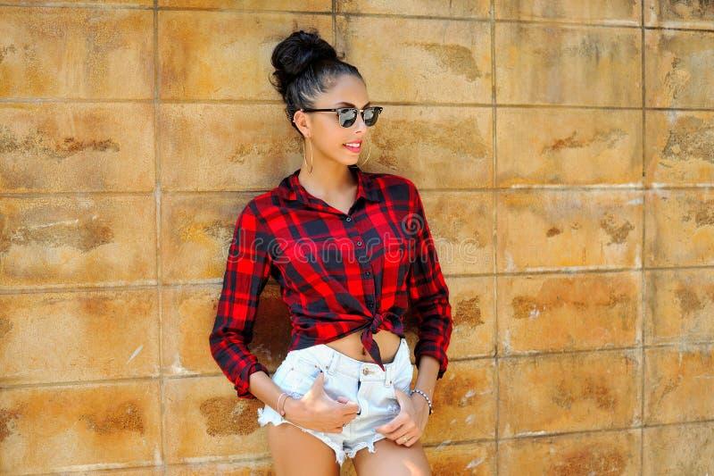 Fashion portrait of beautiful stylish young woman in sunglasses royalty free stock photo